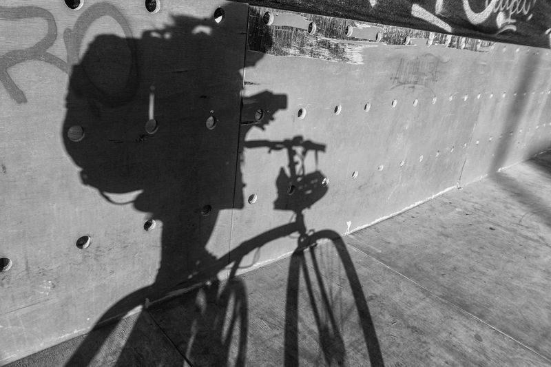Shadow Sunlight Bicycle Real People Day High Angle View One Person Transportation Lifestyles Mode Of Transportation Land Vehicle City Outdoors Men Built Structure Focus On Shadow Blackandwhite