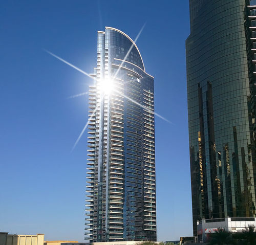 Architecture Blue Building Building Exterior Built Structure City Clear Sky Day Dubai JLT Jumeirah Lakes Towers Lens Flare Low Angle View Modern Office Building Sky Skyscraper Sun Sunbeam Sunbeams Sunlight Sunny Tall - High Tower UAE
