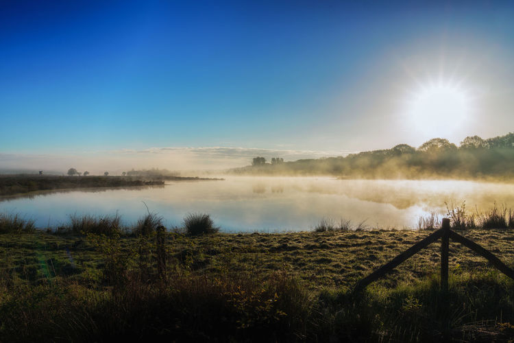 Fog Morning Lake Water Nature Landscape Dawn Scenics Beauty In Nature Outdoors Tranquility Sky Reflection Sunlight Sun Day No People Beautiful Background Photography The Great Outdoors - 2017 EyeEm Awards Lost In The Landscape