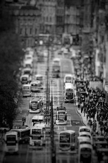 Tilt-shift image of cars on road in city