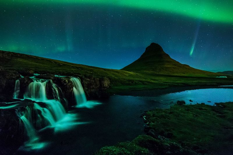 Mount Kirkjufell under the aurora, Iceland Astronomy Aurora Aurora Polaris Beauty In Nature Canon Green Color Kirkjufell Lake Landscape Long Exposure Motion Mountain Nature Nature Night No People Outdoors Samyang Scenics Sky Star - Space Tranquil Scene Tranquility Water Waterfall