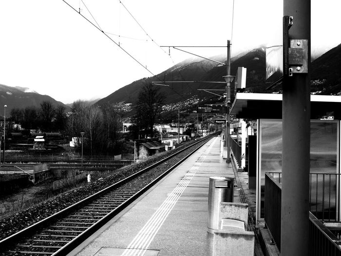 Alps Architecture Bnw Bnw_captures Bnw_collection Cable Day Electricity Pylon Mountain No People Outdoors Public Transportation Rail Transportation Railroad Station Railroad Station Platform Railroad Track Single Track Sky Switzerland Train - Vehicle Train Station Transportation