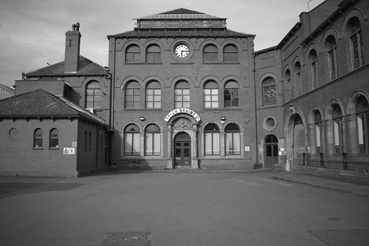 Front view of Braime Pressings building in the once heavily industrialised area of Leeds - Hunslet. Architecture Historical Building Leeds, UK United Kingdom Black And White Clockface Factory Front View
