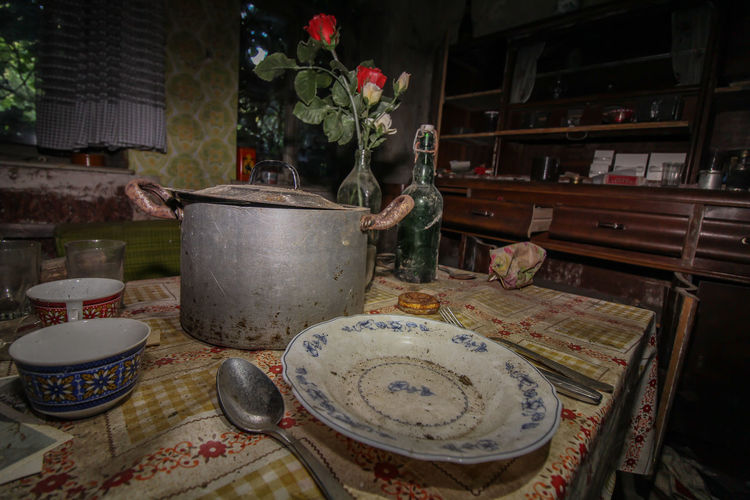 Abandoned kitchen utensils on table at home
