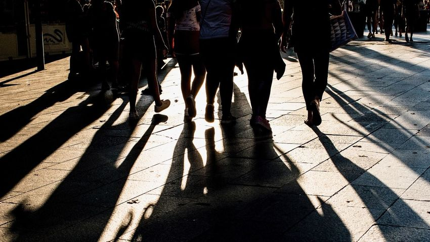 Shadow Group Of People Sunlight Real People Low Section City Lifestyles People Medium Group Of People Body Part Walking Adult Women Human Body Part Human Leg Transportation Nature Street Day Men