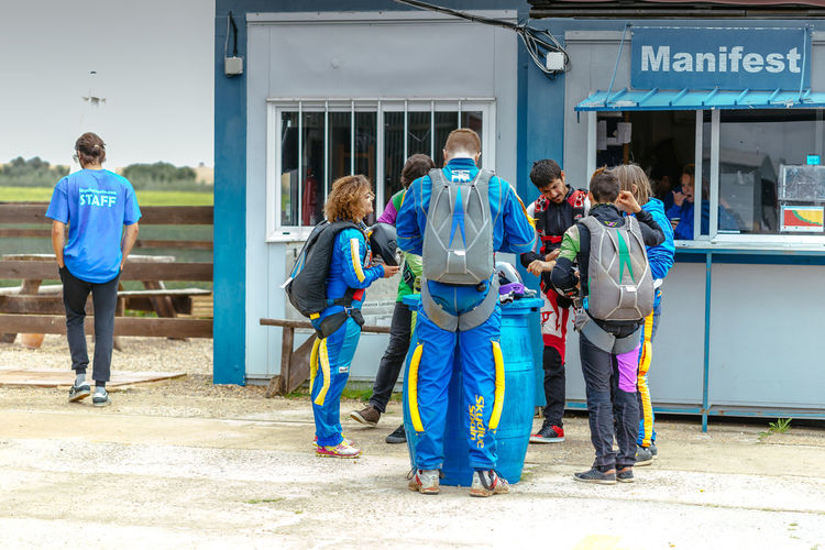 Group of skydivers preparing to fly at La Juliana Aerodrome, Seville, Spain. Adrenaline Adventure Aerodrome Altitude Club Course Cute Diver Exploring Freefall Fun Girl Hobby Instructor Jumpers  Man Parachute Sky Skydive Skydivers Skydiving Sport Training