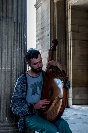 Arts Culture And Entertainment Beard Building Exterior Day EyeEm Gallery Guitar Lifestyles Lourve Men Mid Adult Music Musical Instrument Musician One Person Only Men Outdoors People Performance Performing Arts Event Playing Plucking An Instrument Real People Street Performer The Street Photographer - 2017 EyeEm Awards