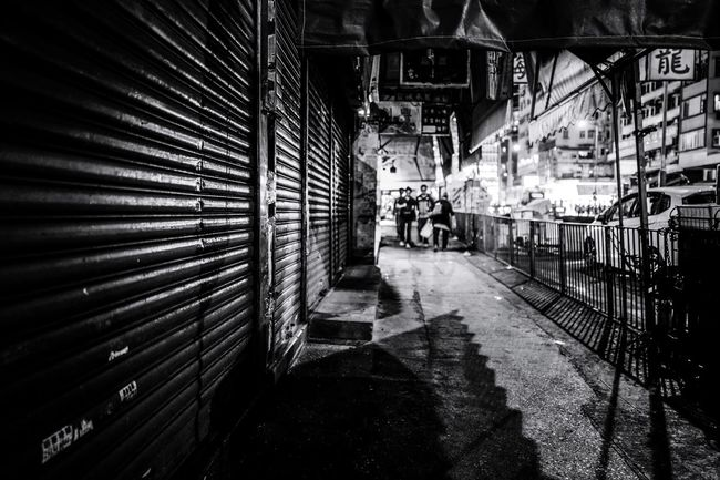 Street Photography Reframinghk Discoverhongkong Blackandwhite Monochrome Architecture Built Structure City Building Exterior Real People Men The Way Forward Direction Day Group Of People Outdoors Transportation Building Metal Nature Sunlight Incidental People Shadow Ceiling