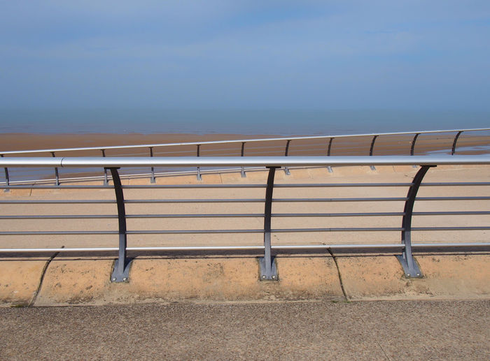 bright modern metal railings along the seaside promenade in blackpool lancashire with concrete sea wall with the ocean and blue summer sky on the horizon Blackpool Promenade Architecture Beach Beauty In Nature Blue Built Structure Clear Sky Day Horizon Over Water Land Nature No People Outdoors Railing Scenics - Nature Sea Seafront Seat Sky Summer Tranquil Scene Tranquility Water