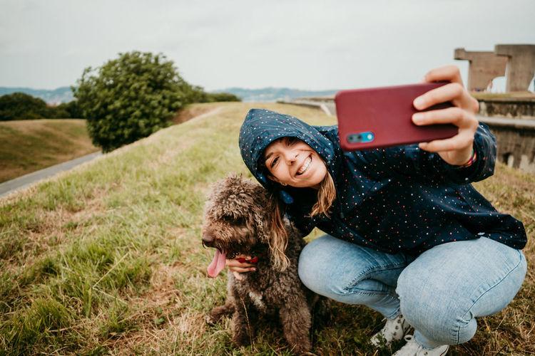 Full length of girl holding mobile phone