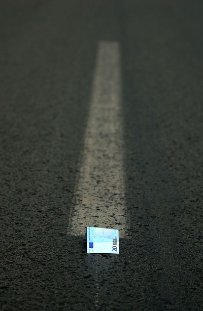 money concept 20 Euro Asphalt Business Road Transportation Close-up Day Euro Europe Middle Of The Road Money Money Concept Nature No People Outdoors Road Road Lines