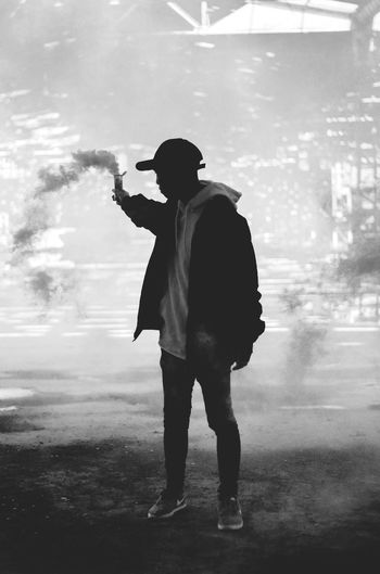 Smoke - Physical Structure Full Length One Man Only Adult One Person Adults Only Steam Only Men People Warm Clothing Leisure Activity Firefighter Headwear Men Real People Black And White Friday Smoke Smoke Bomb Outdoors Be. Ready.