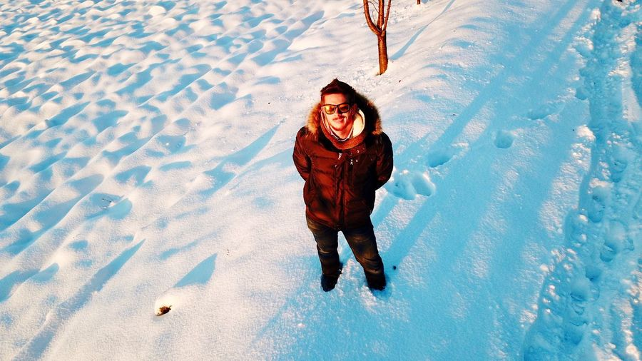 High angle view of man on snow field