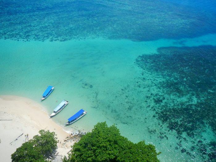 Aerial View Of Boats Moored At Sea Shore