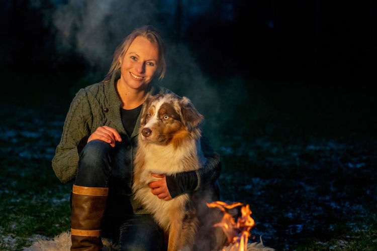 Portrait of woman with dog outdoors