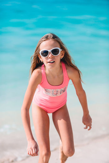 Low angle view of woman wearing sunglasses on beach