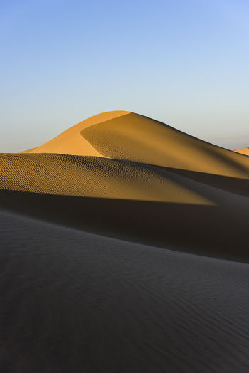 Dunes at the doorstep of Dubai, near a village called Al Faqaa, Dubai Emirates Arid Climate Clear Sky Close-up Day Desert Dry Dunes Hot Landscape Nature No People Outdoors Sand Sand Dune Sandy Shade Sky Sunset