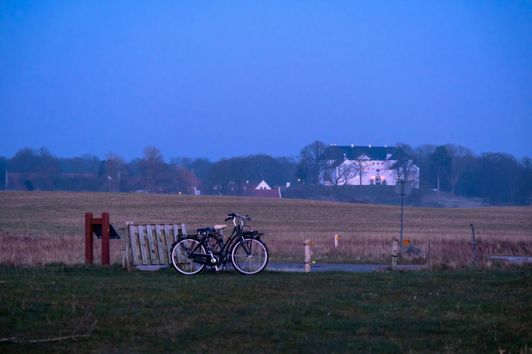 Bicycle on field against sky