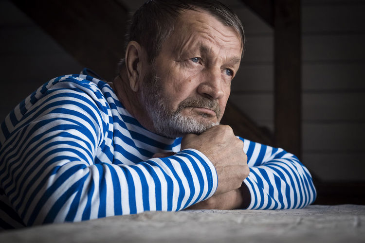 Portrait of man sitting at home