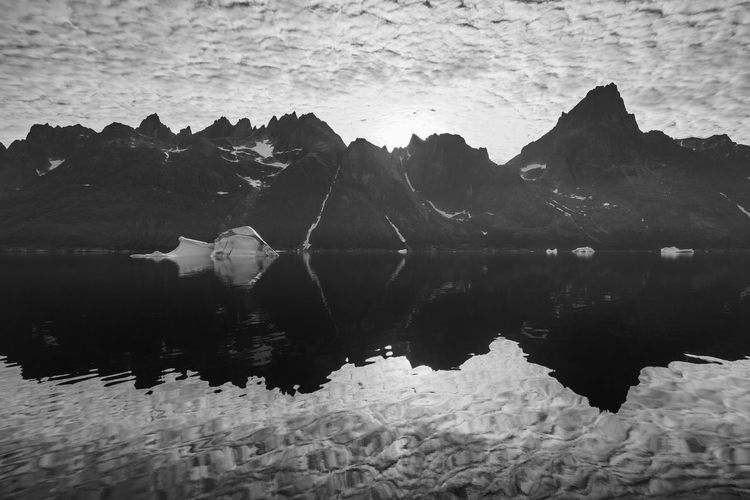 Icebergs and mountains mirror reflecting at Prins Christians Sund, heading up north to the east coast of Greenland. Black & White Global Warming Greenland Melting Arctic Beauty In Nature Black And White Black And White Photography Blackandwhite Climate Change Iceberg Idyllic Lanscape Mirror Reflection Mountain Mountain Range Mountains Nature No People Ocean Reflection Scenics - Nature Tranquil Scene Tranquility Water