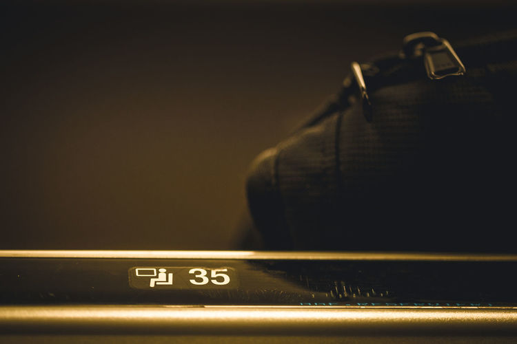 35mm Film Arts Culture And Entertainment Audio Equipment Baggage Baggage Compartment Black Color Close-up Communication Connection Copy Space Equipment Indoors  Luggage No People Number Overhead Compartment Retro Styled Seat Number Selective Focus Still Life Technology Text Train The Traveler - 2018 EyeEm Awards