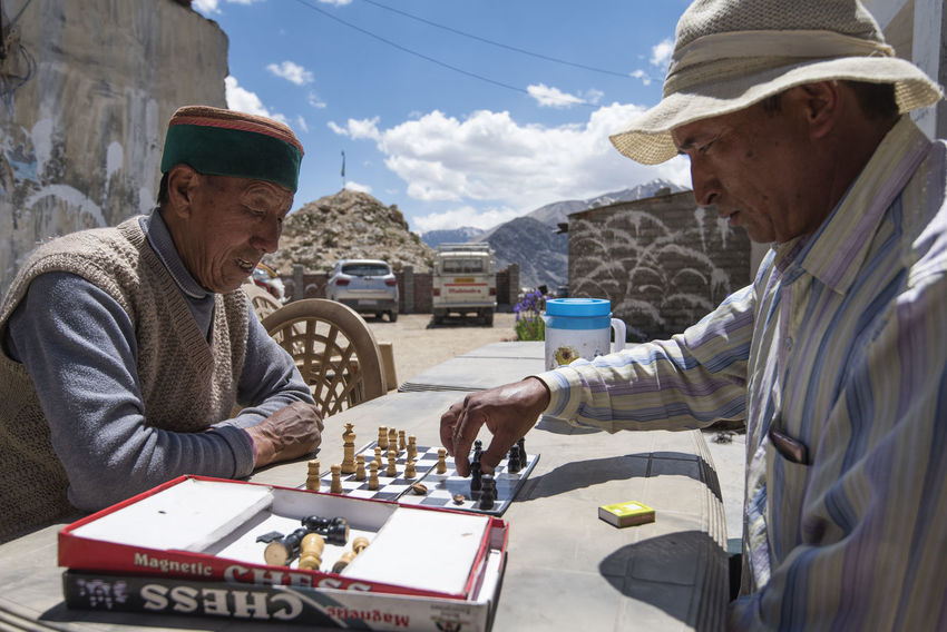 Ealder people playing chest on a lazy afternoon at Nako, Himachal Pradesh. Afternoon Board Games Himachal Pradesh, India Nako Spiti Valley India Travel Cap Chess Day Outdoors Playing Real People Senior Adult Senior Men Sky Spiti Sunlight