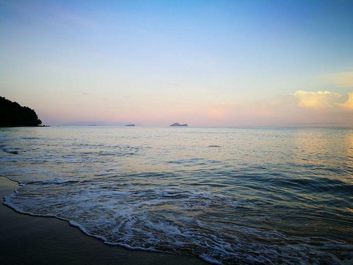 Sea Reflection Beach Sky Blue Scenics Sunrise Nature Tranquility Damaibeach Malaysia Horizon Over Water EyeEm Vision Travel Destinations Sunrise Damai Beach Resort Beauty In Nature Outdoors Water Tranquil Scene Idyllic Sand No People Nature Tranquility Malaysia Kuching Borneo