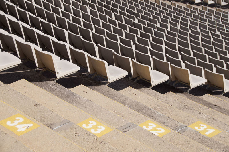 High angle view of empty chairs in city