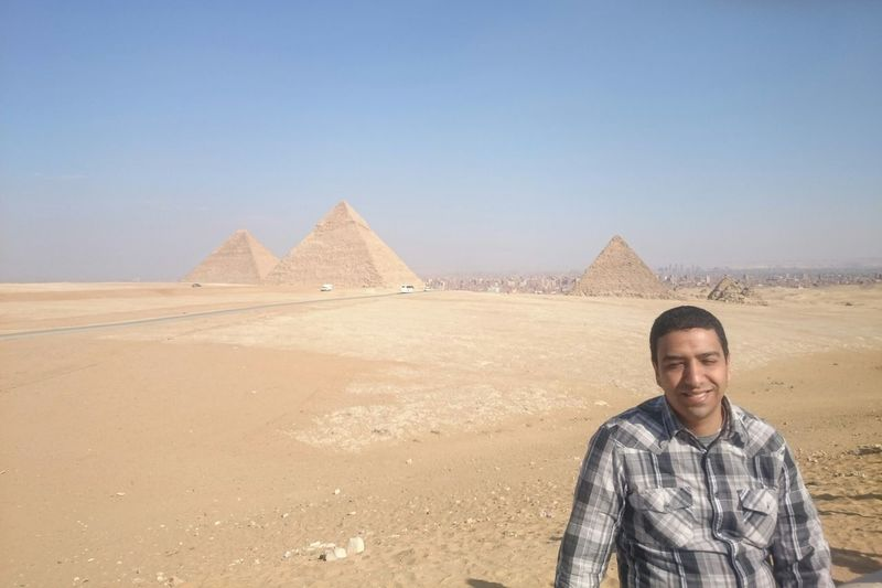 Man Standing Against Giza Pyramid Complex