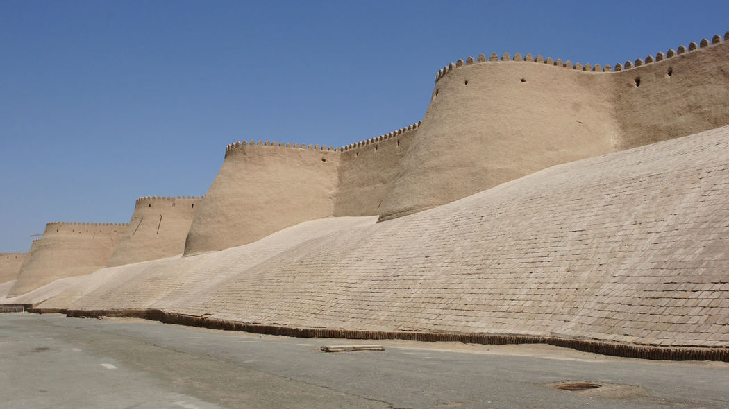 Wall of the ancient city of Khiva, silk road, Uzbekistan, Central Asia Ancient Architecture Architecture Central Asia City City Wall Day Desert Oasis Famous Place Khiva Middle East No People Old Old Buildings Oriantal Outdoors Sights Sightseeing Silk Road Tourism Tourist Attraction  Town Travel Travel Destinations Uzbekistan Vacations