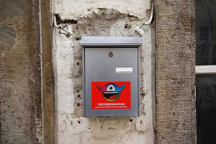 Video Surveillance Warning Sign Letter Box Communication Safety Sign Text Wall - Building Feature No People Built Structure Day Architecture Red Protection Western Script Warning Sign Security Building Exterior Metal