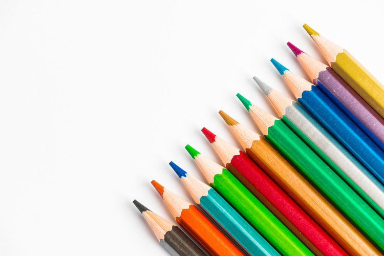 Close-up of colored pencils against white background