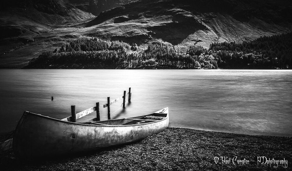 Nautical Vessel Transportation Boat Mode Of Transport Moored Water Mountain Lake Tranquility Tranquil Scene River Non-urban Scene Scenics Nature Beauty In Nature Riverbank Tourism Silence Shore Mountain Range Monochrome Atmospheric Mood Mono Lakes  Lake View