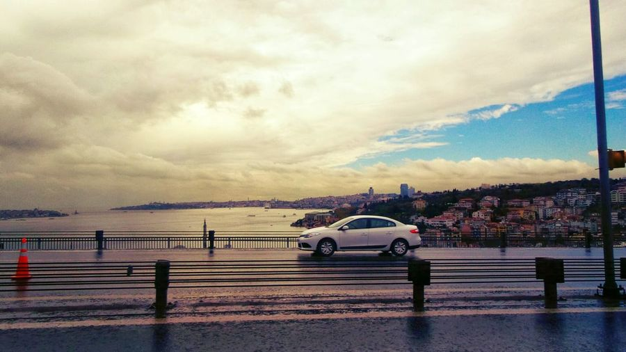 Feel The Journey Car City Life Cityscape Photooftheday Traveling Across The Sea Across The Sky Across The Bridge iFromeuropetoasia Clouds And Sky Cloudy Day Cloud