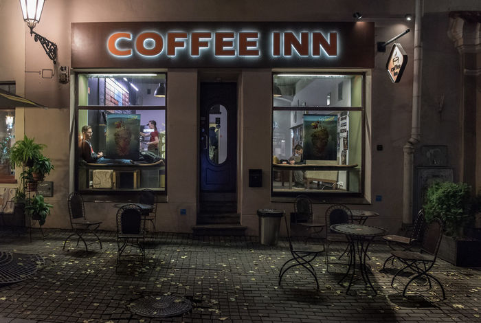 Coffee Inn, coffeeshop in Vilnius at the evening Coffee Vilnius Architecture Business Cafe Caffè Chair Coffeeshop Communication Day Empty Entrance Food And Drink Glass - Material Illuminated Night Outdoors Restaurant Seat Sign Table Text Transparent Western Script Window