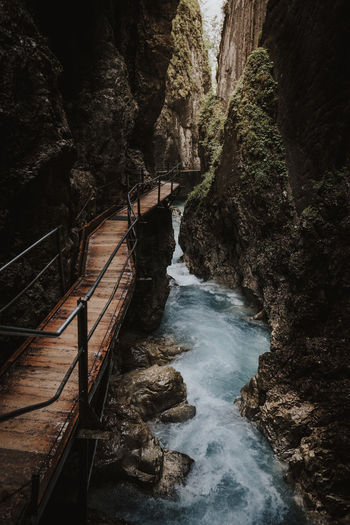High angle view of bridge over waterfall in forest