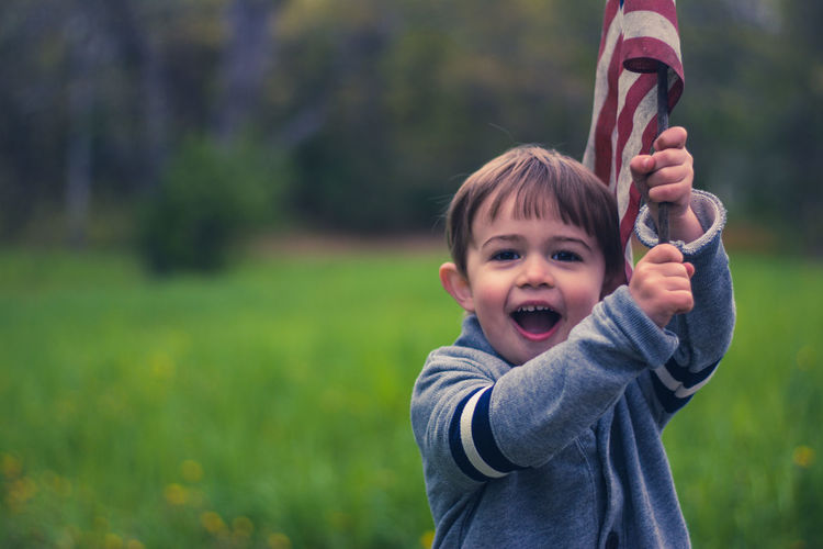 American Flag Children Cuteness Happy Laughing Little Boy Patriotic Patriotism Adorable America Beauty In Nature Boy Boys Child Childhood Childhood Memories Children Only Children Photography Cute Cute♡ Flag Handsome Handsome Boy Smile Smiling
