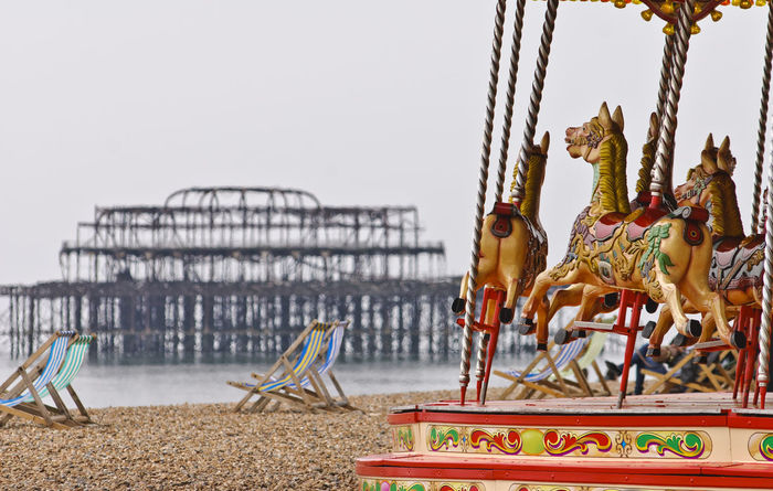 Carousel on Brighton Beach, Brighton Amusement Park Beach Brighton Brighton Pier Britain Carousel Deckchairs England Fairground Fashioned Horses No People Old Outdoors Pebbles Pier Roundabout Sea Seafront Seaside Style Sussex