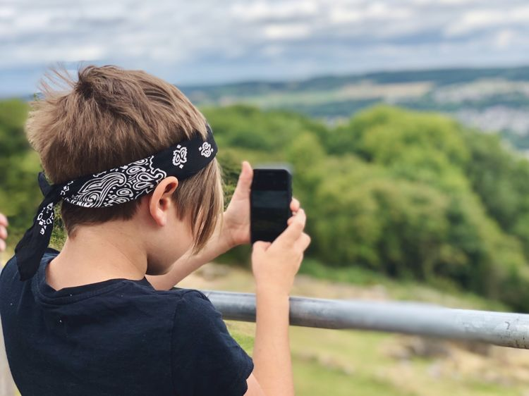 Young male taking photo of landscape with mobile phone EyeEm Selects Real People Wireless Technology Technology One Person Smart Phone Headshot Portrait Portable Information Device Leisure Activity Lifestyles Mobile Phone Communication Focus On Foreground Photographing Fashion Activity