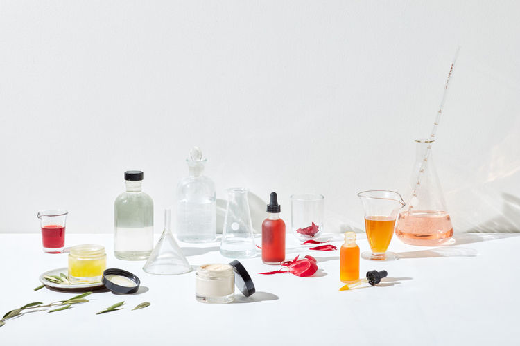 View of glasses on table against white background