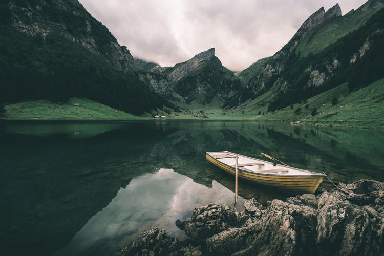 Boat at the mountain lake on a cloudy and moody morning in Switzerland Adventure Alps Appenzell Appenzellerland Boat Laeken Lake Landscape Moody Mountain Mountain Lake Mountains Nature Nature Outdoors Peaceful Postcard Schweiz Seealpsee Suisse  Swiss Swiss Alps Switzerland Tranquility Travel Destinations The Great Outdoors - 2017 EyeEm Awards The Great Outdoors - 2017 EyeEm Awards