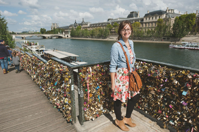 Being A Tourist Built Structure Enjoyment France Friendship Incidental People Leisure Activity Lifestyles Locks Of Love Bridge Nautical Vessel Outdoors Paris Perspective Pier Real People Reflection River Standing Togetherness Tourist Attraction  Water Waterfront Weekend Activities Women