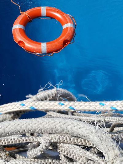 Close-Up Of Ropes Against Inflatable Ring In Pool