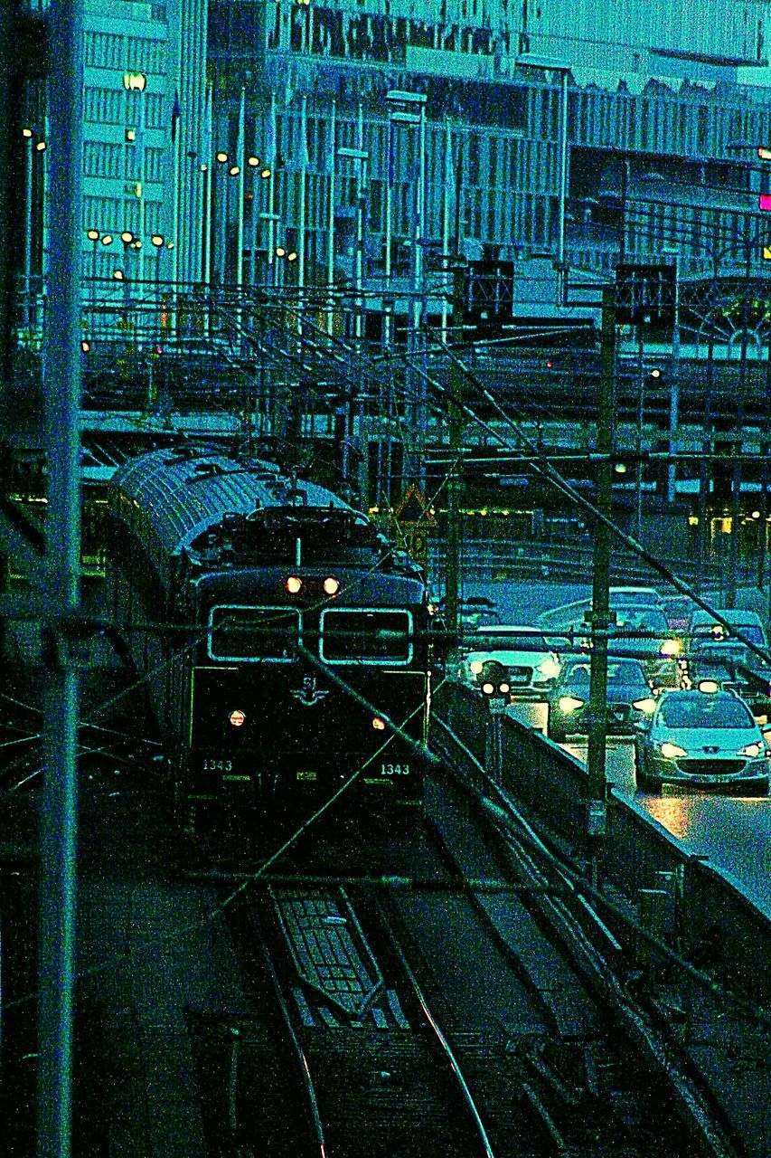 transportation, night, railroad track, no people, illuminated, architecture, city, rail transportation, built structure, outdoors, building exterior, cityscape