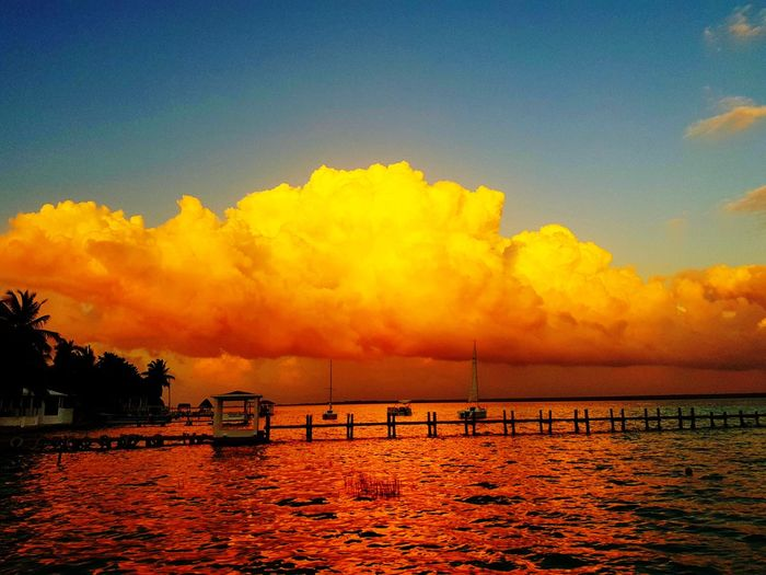 Bacalar al caer el sol #mexico #beach Water Tree Sunset Sea Yellow Reflection Sky