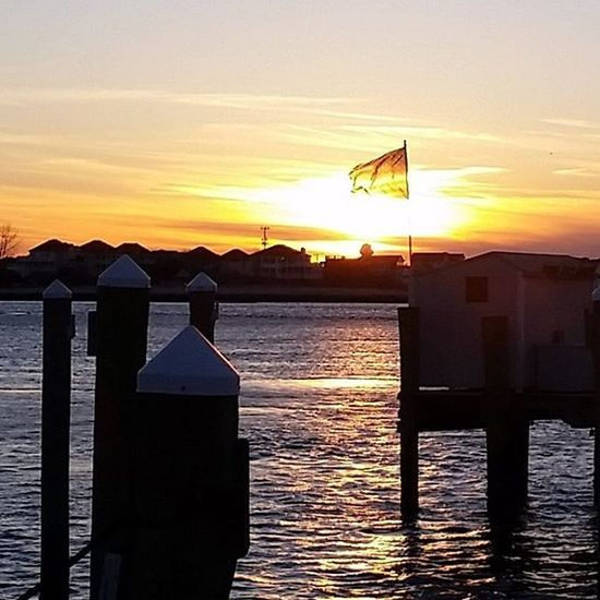 Waving boldly in this evening's breeze... Oceancitycool OceanCity Maryland Ocmd Sunset Flags USA Usflag