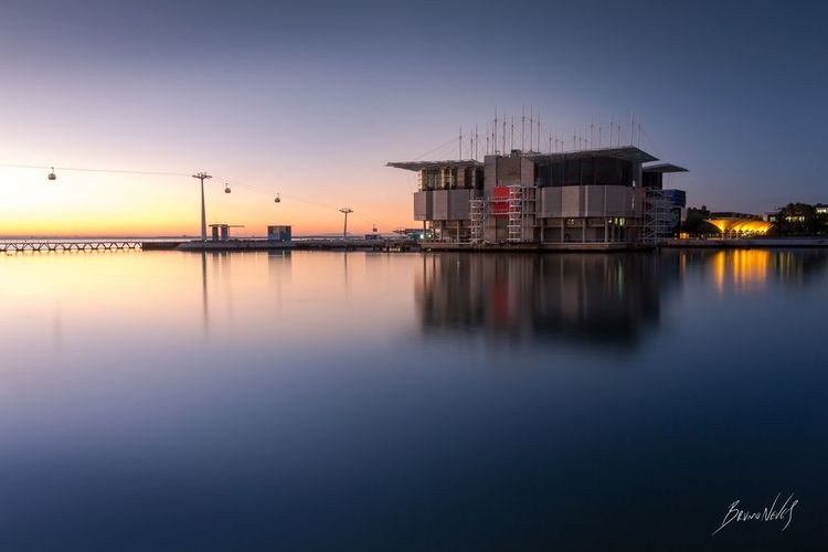 """The Silence Of Dawn"", Lisbon, Portugal. Water Reflection Outdoors Portugal Lisbon Lisboa Dawn Oceanarium Landscape Architecture Building River Tejo Tejo River Tagus Tagus River Long Exposure Blue EOS EOS700D Bruno Neves First Eyeem Photo EyeEmNewHere Bruno Neves"