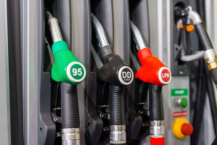 Selective focus photography. Colorful Petrol pump filling nozzles , Gas station in a service in daytime. Economy Gas Gasoline Industry Power Pump Service Station Transportation Auto Car Close-up Diesel Engine Equipment Fuel And Power Generation Gallon Gastropod Oil Petroleum Pistol Refueling Tank