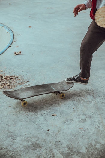Low section of man working on skateboard