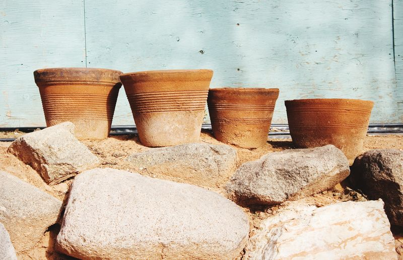 Clay pots In A Row Pots Outdoors Decor Plant Pots Clay Pot Four Objects Simple Things In Life Simple Beauty